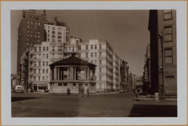1940 Eighth Avenue, (left) east side, north from Hudson Street (foreground), showing the bandstand silhouetted against a new 6-story apartment house. The latter is on Bleecker Street, between the Avenue and Bank Street (right). Irrespective of this, it will bear an Abingdon Square number. To the left is the 16-story apartment house, No. 20 Abingdon Square, located at the S. E. corner of 8th Avenue and W. 12th Street.  View 2 is limited to first mentioned feature. The dark 5-story dwelling at the left is No. 4 Abingdon Square.  May 12, 1940 April 9, 1940 (from www.oldnyc.org)